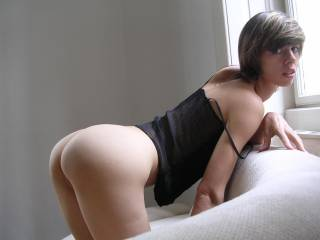 A beautiful woman - perfectly exposed in picture.....now about that ass, suggest licking to O followed by long, slow fucking!