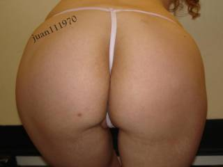 Nice ass! Love the pussy peeking out under that thong babe!