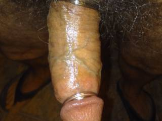 Hard oiled cock. I'm naked except for cock rings and flip flops
