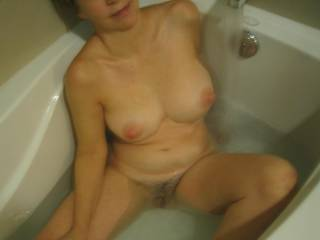 I\'m love warm baths...playing with my tits and pussy, with Bert\'s cock right at mouth level!