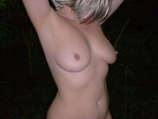 I want to rub the head of my cock on her nipples until I spray my cum all over them