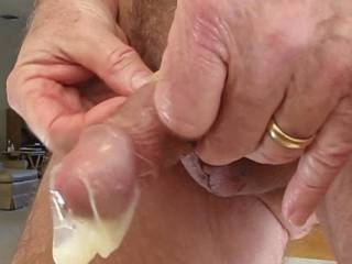 Mr. F obviously goes flaccid quite quickly after he cums, but he did do a good job of filling that condom.  From Mrs. Floridaman