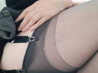 Decent suspenders keep Sally\'s stockings firmly in place but also ready to show when she sits down.