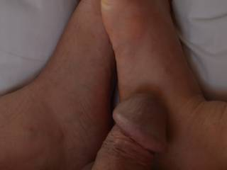 When I masturbate my cock using my feet it make me so horny