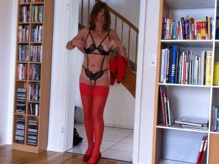 when she needs a fuck she wear some lingerie and enters the living room presenting herself to everybody