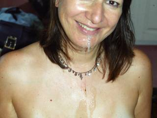 A satisfied grin on my face after swallowing a thick load of yummy cum. Some spunk is dripping on to my tits, which is such a turn on !