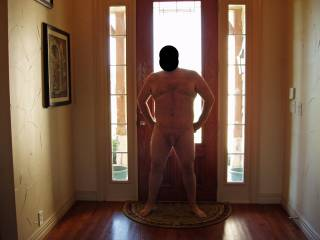 Posing hubby nude by the front door.  I was hoping for a knock at the door!