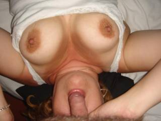 Sucking on cock with my tits out