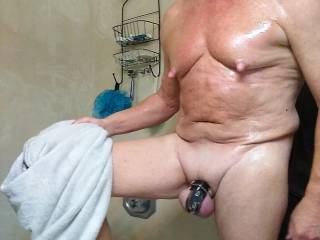 Drying off after a hot shower. In chastity.