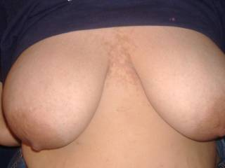 It takes two hands to lift that nipple to my mouth, or would you prefer to feed me while I use hands to massage your pussy?
