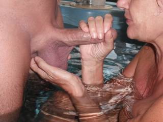 Playing with my Hubby\'s lovely big smooth thick cock and balls in the spa at home.