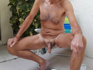 I am enjoying our semi-private courtyard here in Tampa. , and showing off my cock, of course.