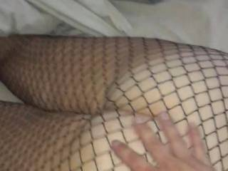 Kate wearing her sexy fishnets getting a good hard spanking...