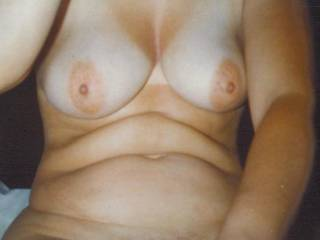 My wifes tits when she was younger.  Damn did I love her tits and nipples.  She love to have me suck them kiss then and cum all over them