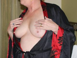Showing her lovely tits in her new outfit.  Aren\'t they beautiful?