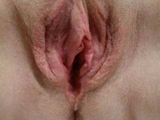 A closeup of her moist spread pussy after a warm up.. What next ??