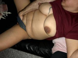 He fingers her wet pussy on the couch
