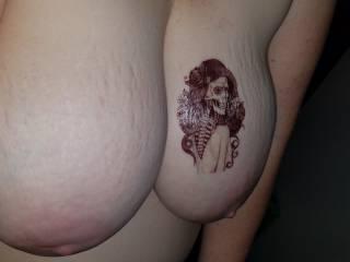 Temporary tattoo on her big tits