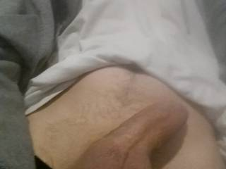 on my bed getting my uncut cock hard ready to cum