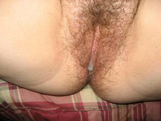 My cum sliding out her hairy pussy