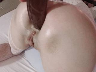 Now and then he\'ll just turn me loose and watch me work the toy for myself. This time, while he jerked himself waiting for my pussy to spew, he let go and put is load right over my ass! It oozed its way down to where it made good lube for the dildo!