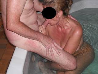 Sucking our swinger friend\'s extra thick cock in his spa
