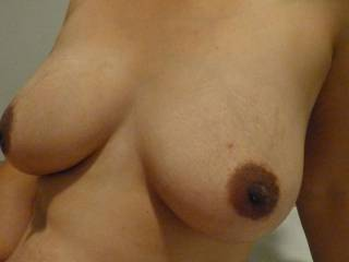 love the big tits and hard brown nipples  would love to place my hard cock between them and titty fuck you  i would cumm all over them then lick and suck that pretty pussy of yours till i get your honey all over my face