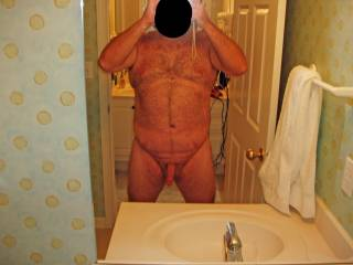 Summer 2008 Beach Vacation.  Hubby posing in the nude at our condo!