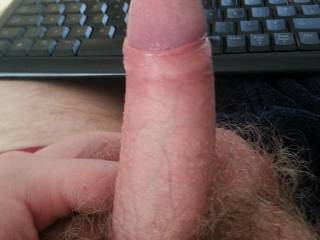 And a nice one at that I like to see a nice uncut cock with its head pushing though it's foreskin