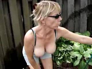 Nice titties....now if you'd do some lawn work for us with that little ass showing...THAT would be very nice thing for us to watch!!!