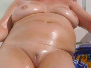 Love the shine the oil puts on your fabulous curves and smooth pussy! You should be taking a stiff cock between those sweet lips - let me volunteer! Lee