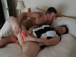 After our new friend made love to me on his bed he wanted to lay back and watch me pleasure myself using on of my toys whilst my hubby stood and watched