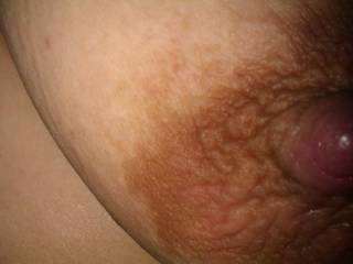 A close up of my wife\'s large nipple and areola.
