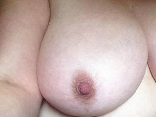 Hehehe, definitely a handful and a half.   Would love to squeeze it in my hand, feeling the soft flesh beneath my palms and fingers, then lift it to my mouth so that I can suck on that hard nipple...