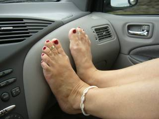 The beautiful feet of my wife on the dashboard. Really sexy for truckers