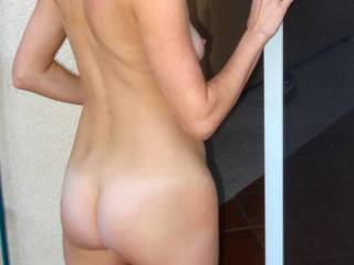 Heading inside after some nude tanning in the back yard, how my ass look?