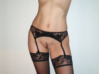 No bra, no panties... Just my garter belt and stockings, a beautifully wrapped gift... accentuating the curves of my hips, framing perfectly my trimmed pussy and thigh highs, drawing my lover\'s attention to the areas i want him to caress...