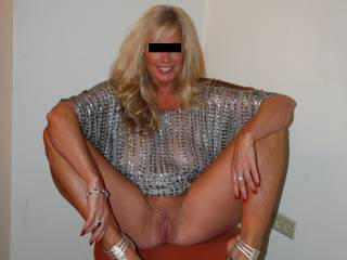 "All dressed up for dinner at a swingers resort. This little (5\'0"") firecracker is a wonderful mix of sweetheart, professional woman and wild slut. We\'re always interested in meeting very select, educated men in the Central Virginia area."