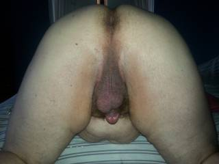 My man from behind..kneeling on the bed getting ready for me to lick him. He loves having me lick him from his balls to his ass and I love to hear his moans when I do it.