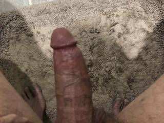 "Looking down at my dick getting ready to jerk off. I wish the head was larger and that I kept the circumference all the way to the end. 40 years f jacking off with my left hand has caused the right side of my cock to ""slope in"".I can still get 3 loads/day"