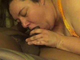 Wife sucking a big black cock