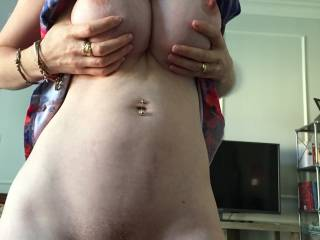 I'd love to be kissing, sucking and nibbling on that hot body....I'd start with those hard nipples and work my way down  to that wet, tasty pussy...