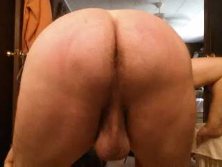 I think that is one hot hairy ass that I would lick and some big balls I would love to suck on