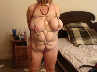 Great body, marvelous tits, artful bondage, nice clamping... Her waiting surely will be rewarded.