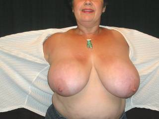 Love your gorgeous tits love to suck on those pert nipples and rub my cock between them got to stop now cause ive got a large bump in my pants