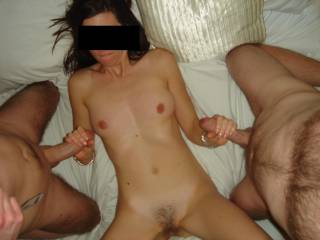 Naked between two horny guys...just what she loves