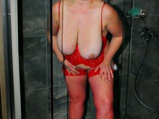 Fucking hot! Gorgeous boobs and this red outfit is so tempting!