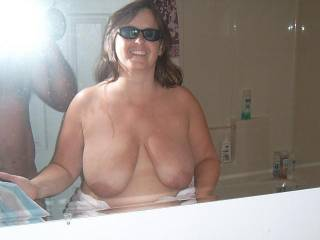 Oh what big beautiful breasts she has...would love to slide my hard cock between them and shoot a big load of cream all over them too...very lovely woman