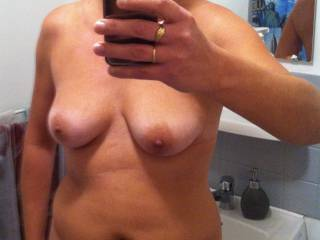 Nice selfie my wife send to me.  Do you love her? Someone to cum on her ?