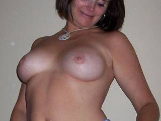 Gorgeous very pretty milf showing off her hot body and very sexy beautiful tits in such a mind blowing erotic fashion!  WoW!